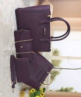 Used Prada purple 4in 1 sets of bag in Dubai, UAE