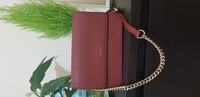Used DKNY new burgundy cross body bag in Dubai, UAE