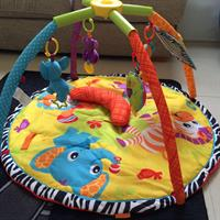 Infantino Twist And Play Activity Gym. Suitable From Birth To Encourage Rolling Over And Motor Skills. In Very Good Condition. Used Only For 2 Months. Twist To Pack Away For Easy Storage And Traveling.