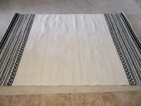 Used Handwoven light cream rug in Dubai, UAE