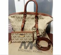 Used michaelkors authentic preloved bag and wallet with dust bag  in Dubai, UAE