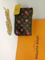 Used Lv sling bag flower design in Dubai, UAE