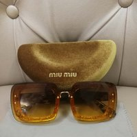 Used ORIGINAL MIUMIU SUNGLASSES.. LIKENEW in Dubai, UAE