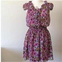 Guess Purple Floral Dress. Never Worn. No Tags. Above Knee Length. Lining Underneath