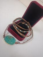 Used Marin jasper bracelet Gold new in a box in Dubai, UAE
