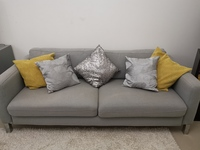 Used Grey 3 seater Sofa with free pillows in Dubai, UAE