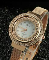 Pearl dial golden watch