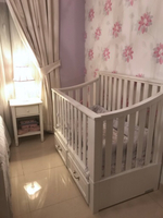 Used Pottery Barn white wooden baby crib in Dubai, UAE