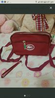 Used LACOSTE sling bag or can be pouch in Dubai, UAE