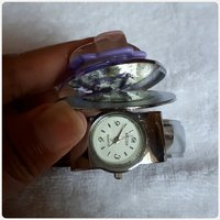 Watch with purple stone to close