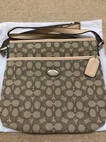 Used Coach crossbody sling bag wheat color in Dubai, UAE