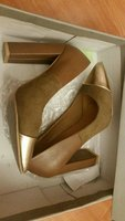 Used Briwn/gold color shoes size 37 once used in Dubai, UAE
