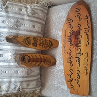 Used Coran script on wooden art in Dubai, UAE