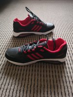 Used New cool red and black sneaker - US 9 in Dubai, UAE