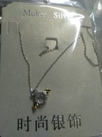 Used Angel and demon twinkling necklace in Dubai, UAE