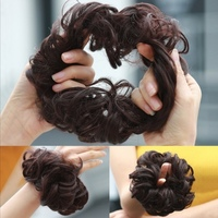 Used 2 pcs brown hair bun elastic band in Dubai, UAE