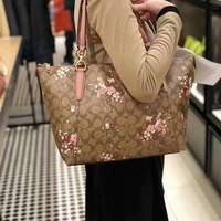 Used Coach Signature canvas floral zip tote in Dubai, UAE