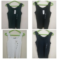 Used sleeveless shirts 4 pcs Brand Kiabi in Dubai, UAE