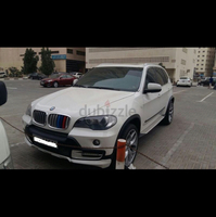 Used Beautiful BMW X5 (Full options No.1) in absolutely perfect condition. Very low km because used only in weekends. Always kept in covered parking. No faults and no errors. Extras include: -Brand new headlights (Magnetti Marelli) white LED Halo+Xenon -21 inch OEM sports RIMS -Daytime running lights on front fascia (ordered from USA) -OEM Roof Rails platinum colour (2011 model) -M power Vinyls in rear quarter and front grille -Carbon fibre vinyls interior (center console & dash) -Sport option in transmission -High quality smoke screen on tail lights Other full options included like panoramic roof, ABS, TCS, cruise control, navigation, etc. No need to spend a dirham. Recently done major service + new brakes installed. Just drive away ! Reason for sale - Getting another vehicle. Price negotiable for serious buyers. in Dubai, UAE