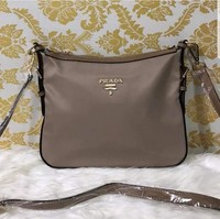 Used Prada sling bag, beige color in Dubai, UAE