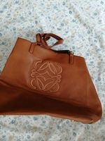 Cute tan leather bag with design