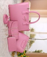 Used Prada pink 4 in 1 sets of bag in Dubai, UAE