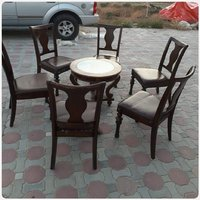Used 6 pcs solid wood chairs with round table in Dubai, UAE