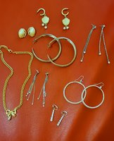 Used Assorted earrings and a necklace in Dubai, UAE