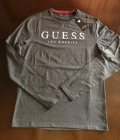 Used Guess tshirt new original in Dubai, UAE