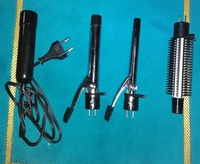 Used . Curling iron with brush styler new. in Dubai, UAE