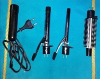 Used Curling iron with. brush styler new. in Dubai, UAE