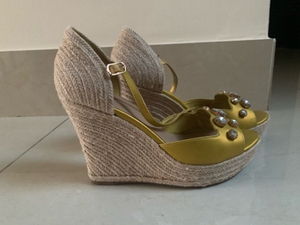 Used Charles & Keith wedges in gold in Dubai, UAE