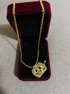Used New golden necklace with dragon charm in Dubai, UAE