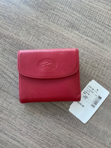 Used Longchamp leather wallet red color in Dubai, UAE