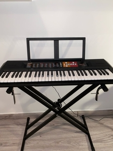 Used yamaha PSR F51 with adapter and stand in Dubai, UAE