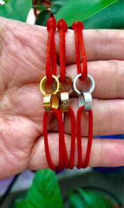 Used Tri colors red ribbon bracelets X 3 in Dubai, UAE