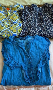 Used shirts size xl and 2 bags in Dubai, UAE