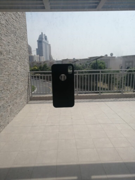 Used Black iPhoneX cover sticks on surfaces in Dubai, UAE