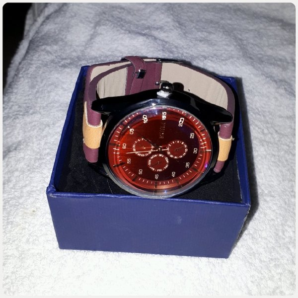 Used Watch maroon color for man in Dubai, UAE