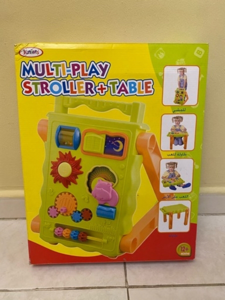 Used Multi play stroller and table in Dubai, UAE