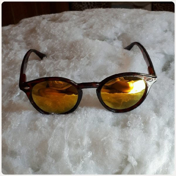 Used Sungglass shiny brown color in Dubai, UAE