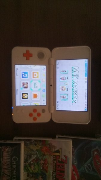 Used Nintendo 2DS XL with 4 games & case in Dubai, UAE
