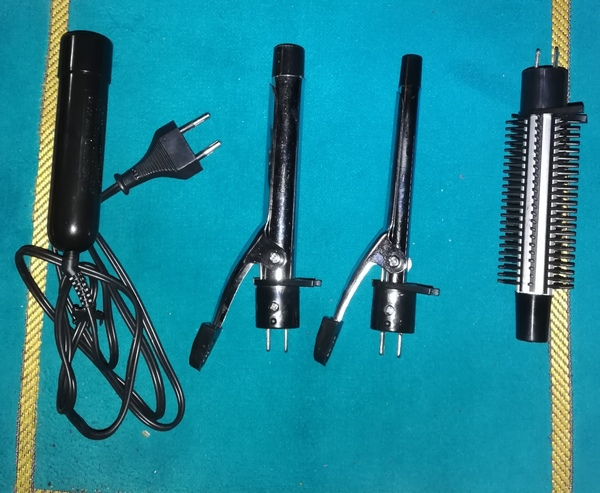 Used Curling iron with brush styler brand new in Dubai, UAE