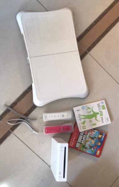 Used Wii comes with 2 controllers & games. in Dubai, UAE