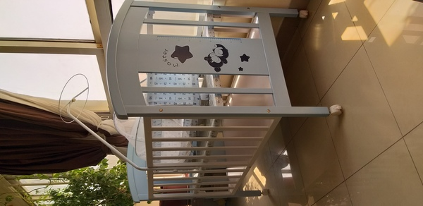 Used Baby cot with swing and storage space in Dubai, UAE