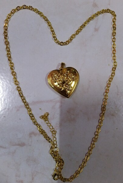 Used Photo necklaces gold & silver 2 pcs in Dubai, UAE