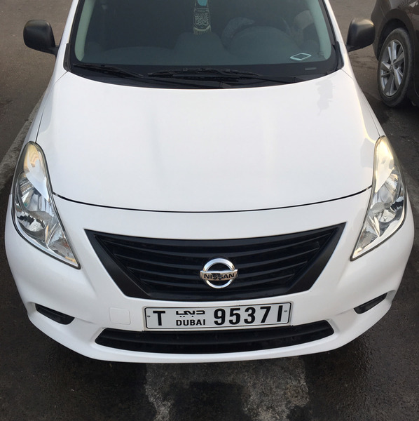 Used Nissan Sunny white color one handed car with awesome condtion call 0551764692 in Dubai, UAE