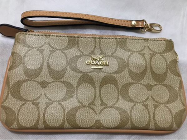 Used Coach wristlet wheat color in Dubai, UAE
