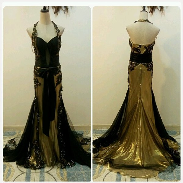 Used Evening long dress golden with black com in Dubai, UAE