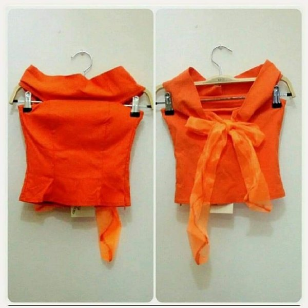 Used Orange croptop brand new small size. in Dubai, UAE